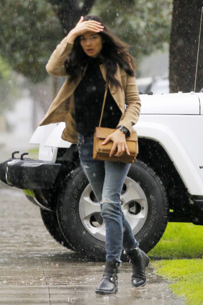 Jessica Gomes out in the rain in Beverly Hills