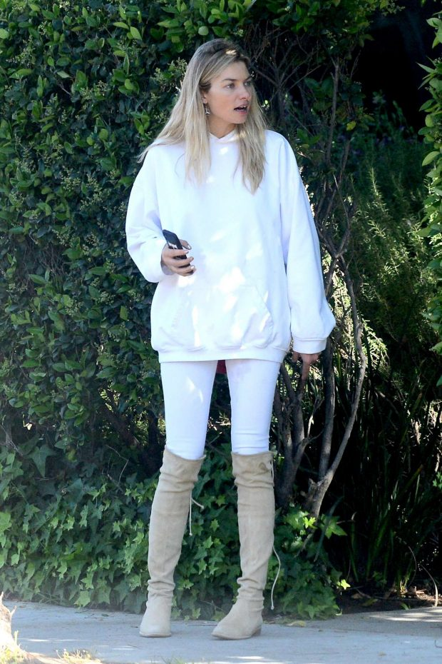Jessica Hart - Wearing overknee boots shopping in West Hollywood