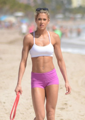 Jill Bunny in Pink Shorts Working Out on the Beach