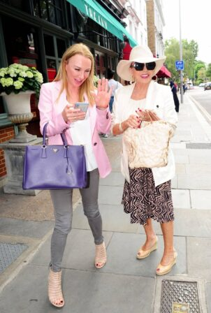 Joan Collins - Looks elegant as she dined with a friend at the Ivy Chelsea Garden in London