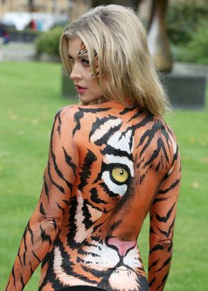 Joanna Krupa - Bodypaint while protesting outside Westminster in London
