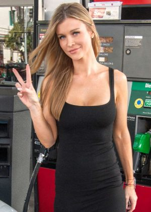 Joanna Krupa in Black Dress pumping gas in Los Angeles