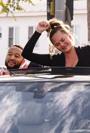 John Legend and Chrissy Teigen celebrate the Joe Biden's win while riding around in West Hollywood