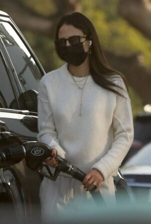 Jordana Brewster - fills up with gas in Brentwood