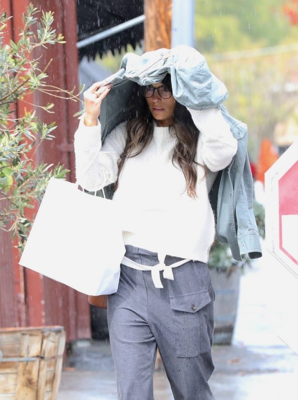Jordana Brewster - Seen on a rain in Brentwood