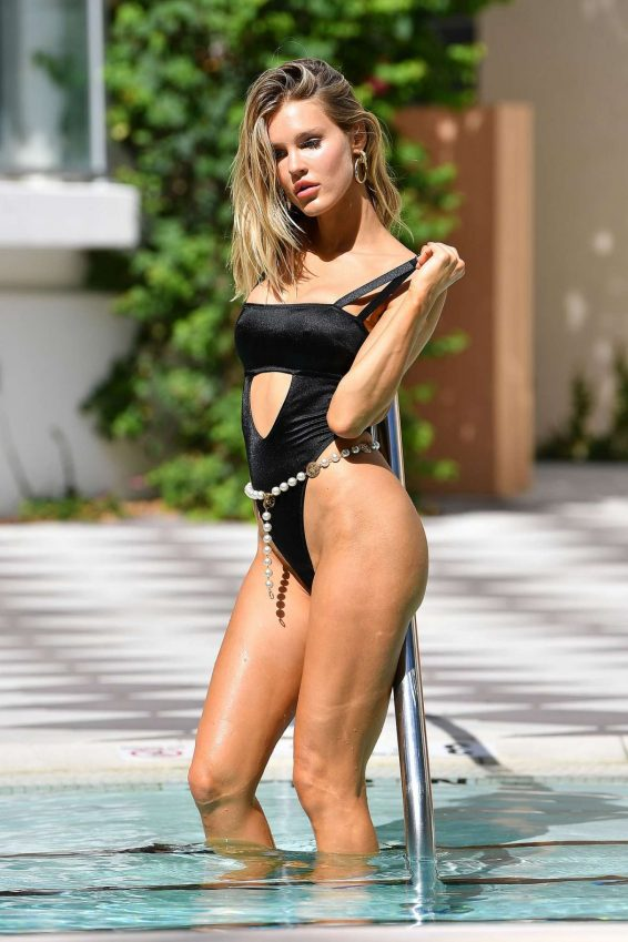 Joy Corrigan in Black Swimsuit at a pool in Miami