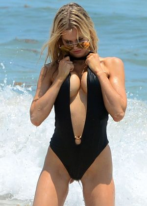 Joy Corrigan in Black Swimsuit on Miami Beach