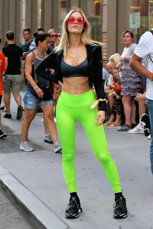 Joy Corrigan - Wearing neon green tights during an impromptu photo shoot in Soho in New York City