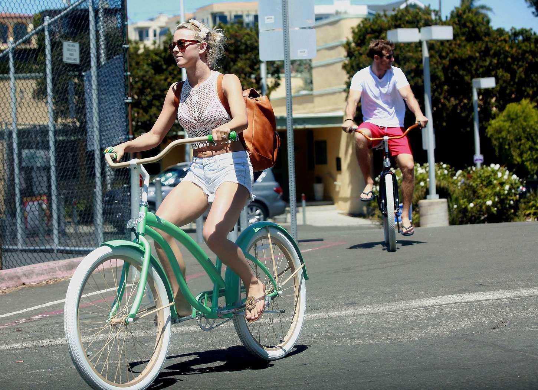 Riding bicycle in bikini
