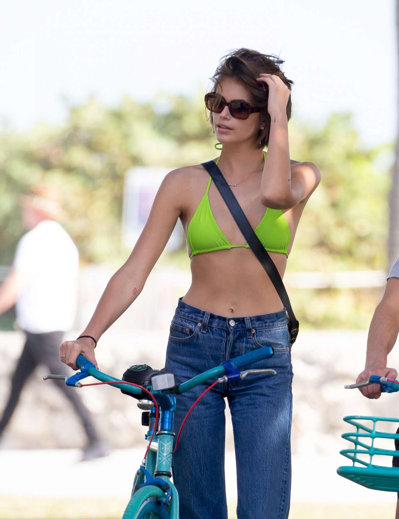 Kaia Gerber in Bikini Top - Bike Riding in Miami