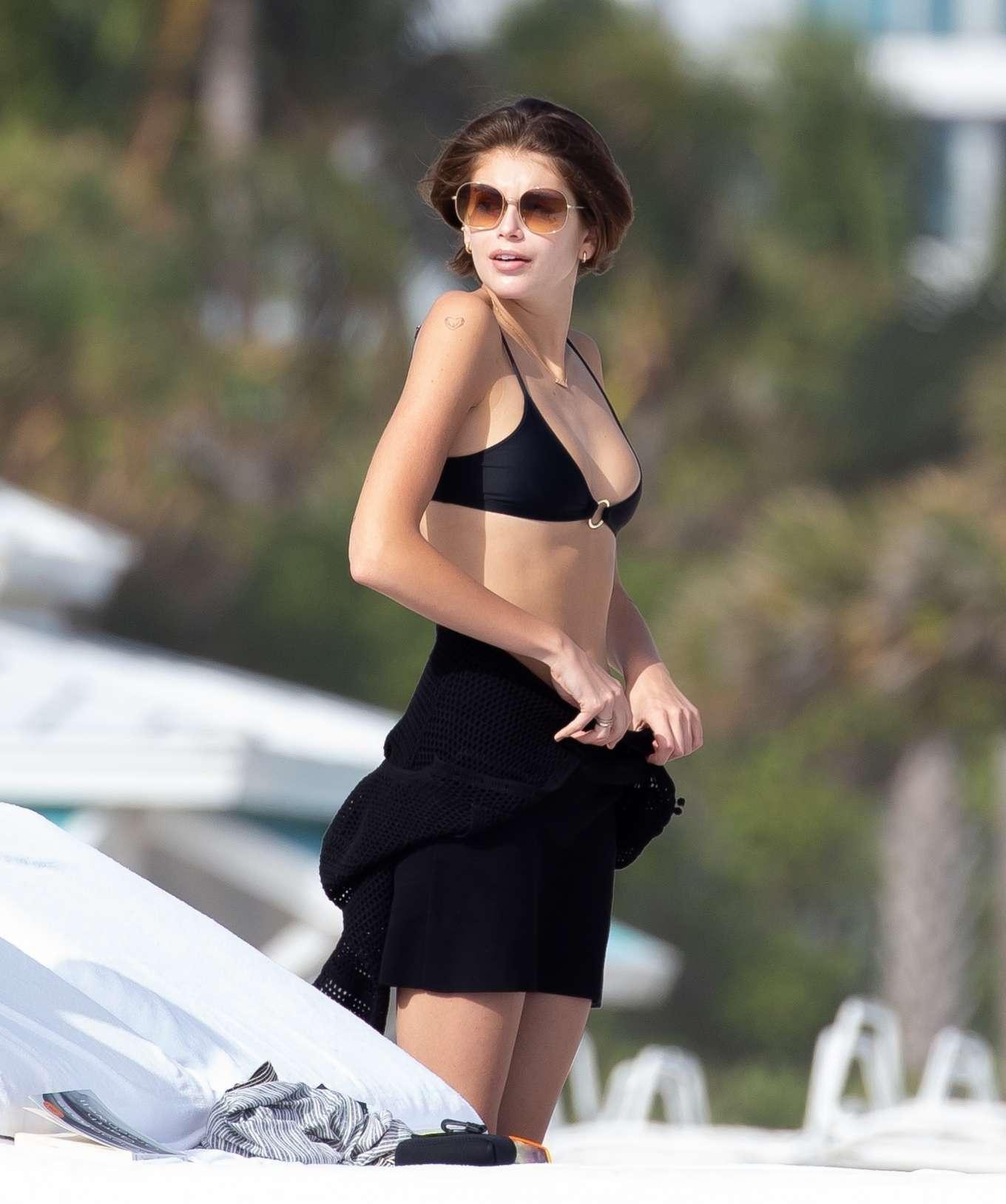 Kaia Gerber in Black Bikini on the beach in Miami