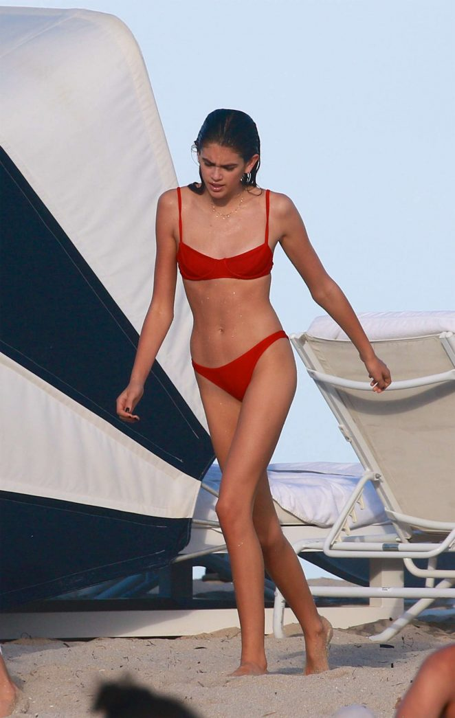 Kaia Gerber in Red Bikini on the beach in Miami