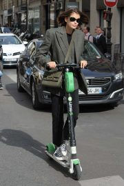 Kaia Gerber - Riding around the streets on a scooter in Paris
