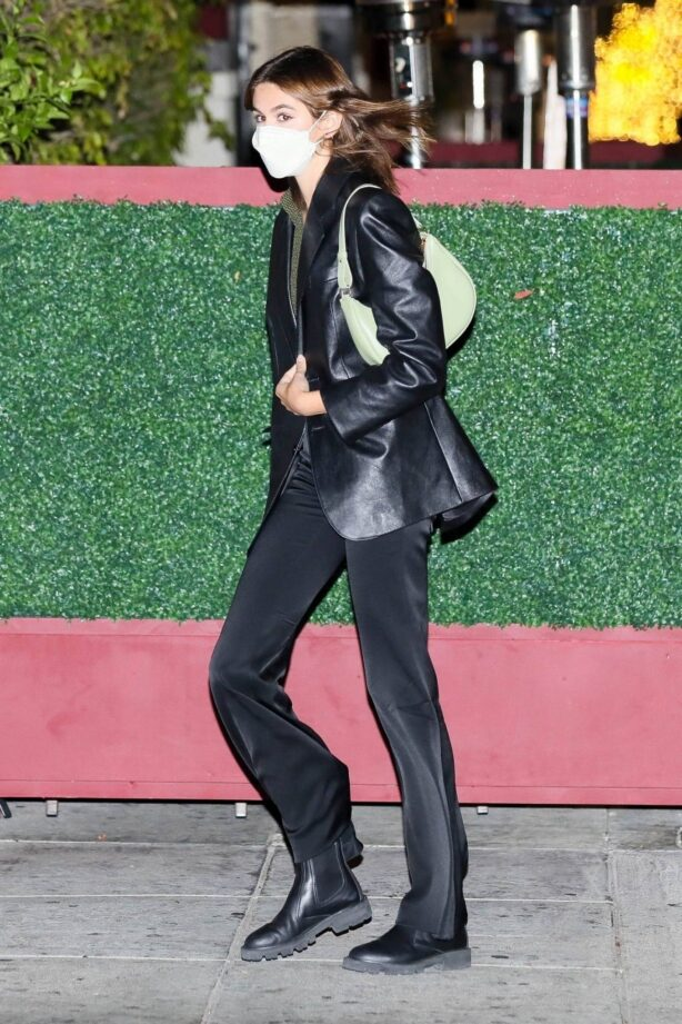 Kaia Gerber - Seen in a leather jacket and black flare pants at Matsuhisa in Beverly Hills