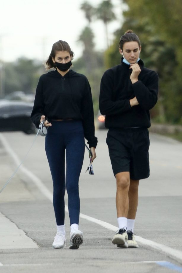 Kaia Gerber - walk with her dog and a mystery man in Malibu