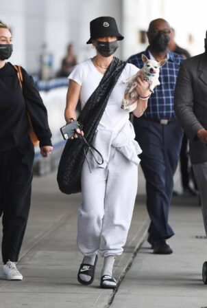 Kaley Cuoco - Arrives with her dog at JFK Airport in New York