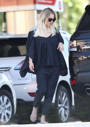 Kaley Cuoco in Black out in Los Angeles