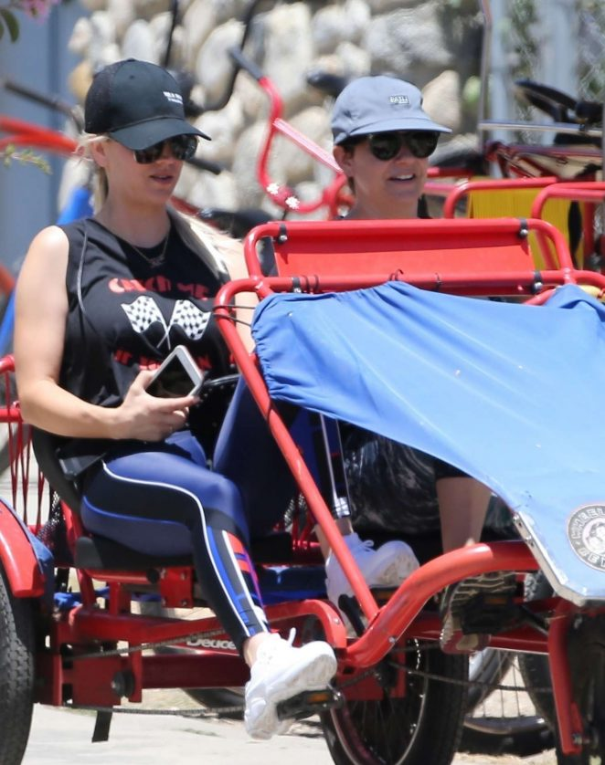 Kaley Cuoco in Tights on a tandem bike in Los Angeles