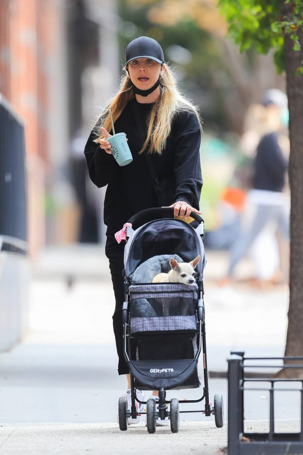 Kaley Cuoco - Out for a stroll with her dog in NYC
