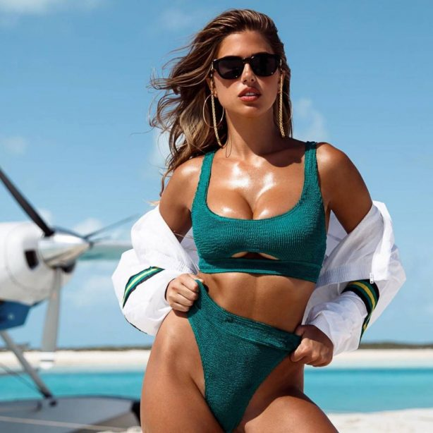 Kara Del Toro on the beach with a water airplane