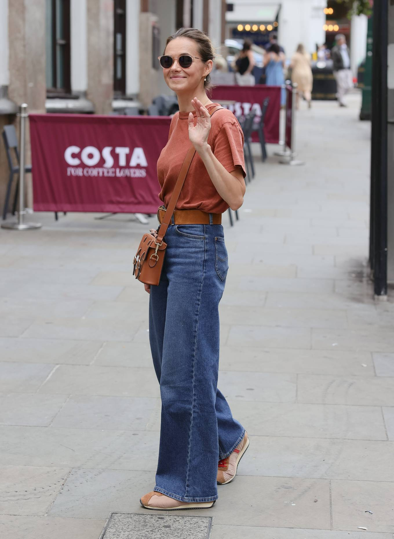 Kara Tointon - In flared denim pants stepping out in London