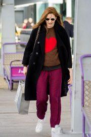 Karen Gillan - Arrives at Heathrow Airport in London