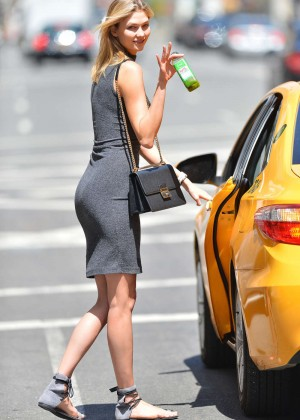 Karlie Kloss in Tight Dress Getting into a cab in NYC