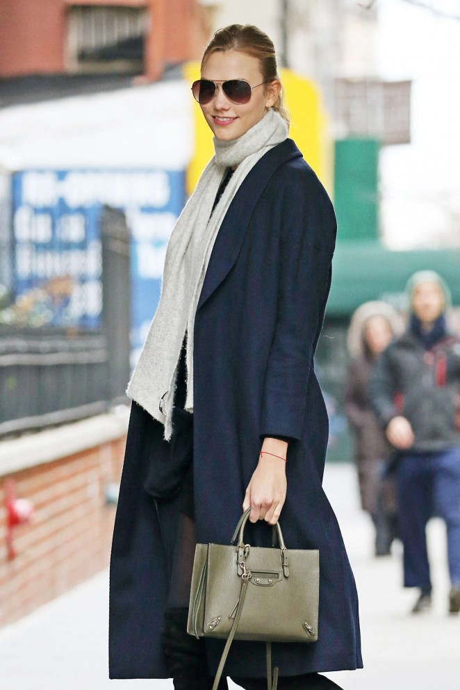 Karlie Kloss in a blue coat out in New York