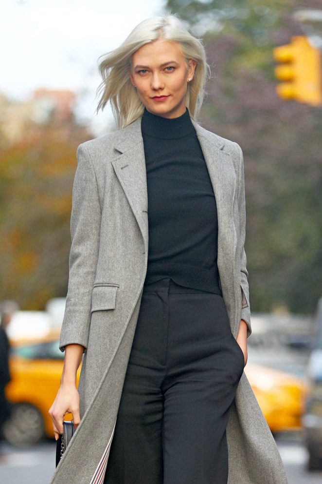 Karlie Kloss in a light grey trench coat in NYC