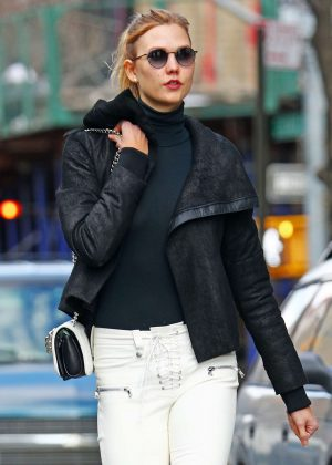 Karlie Kloss in Black leather cropped coat out in NYC