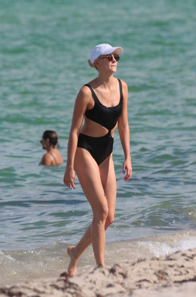 Karlie Kloss in Black Swimsuit at the beach in Miami