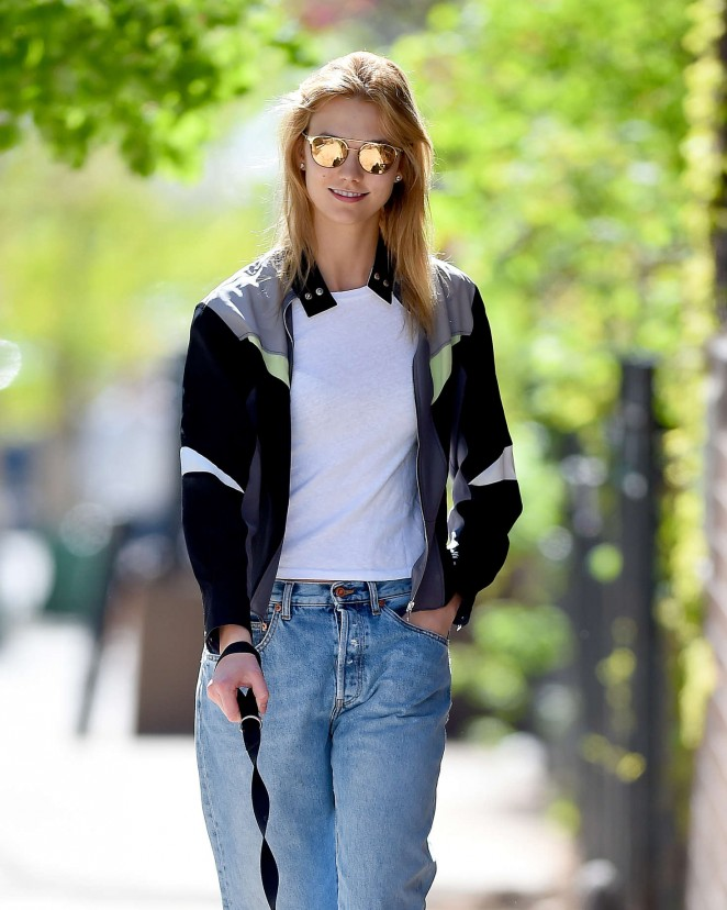 Karlie Kloss in jeans walking her dog in New York City
