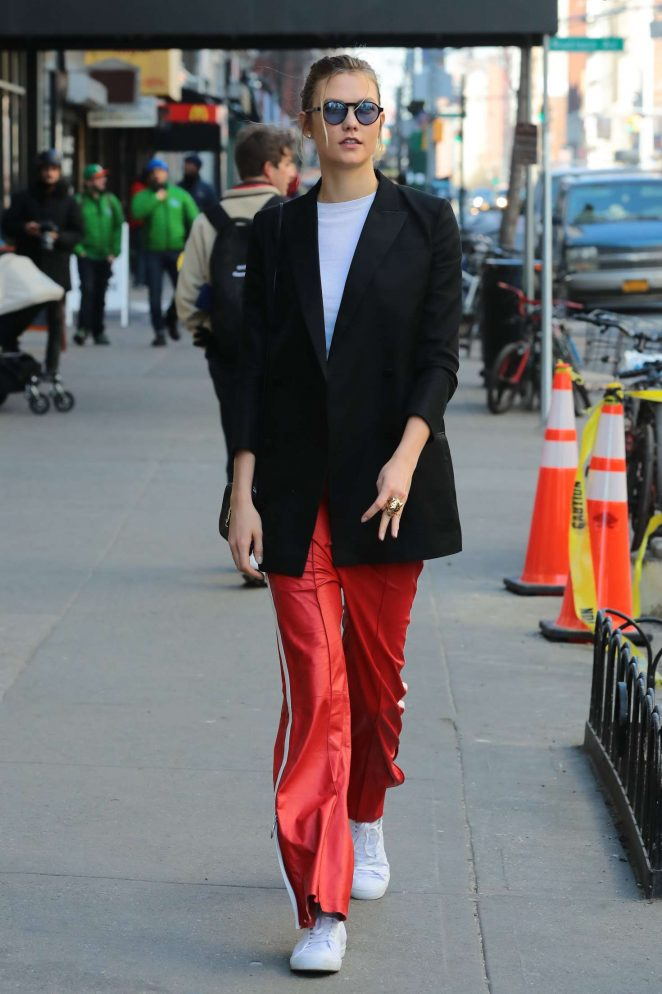 Karlie Kloss in red sport pants out in New York City