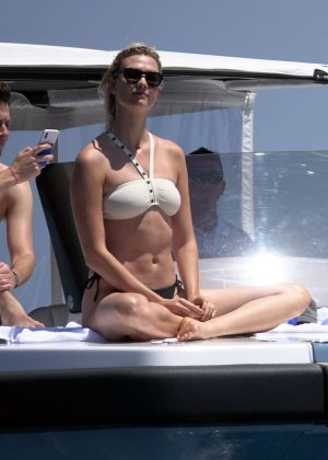 Karlie Kloss in White and Black Bikini on holiday in Capri