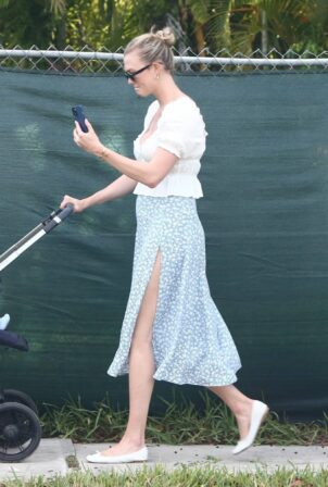 Karlie Kloss - out for a walk with her newborn baby boy Levi Joseph in Miami