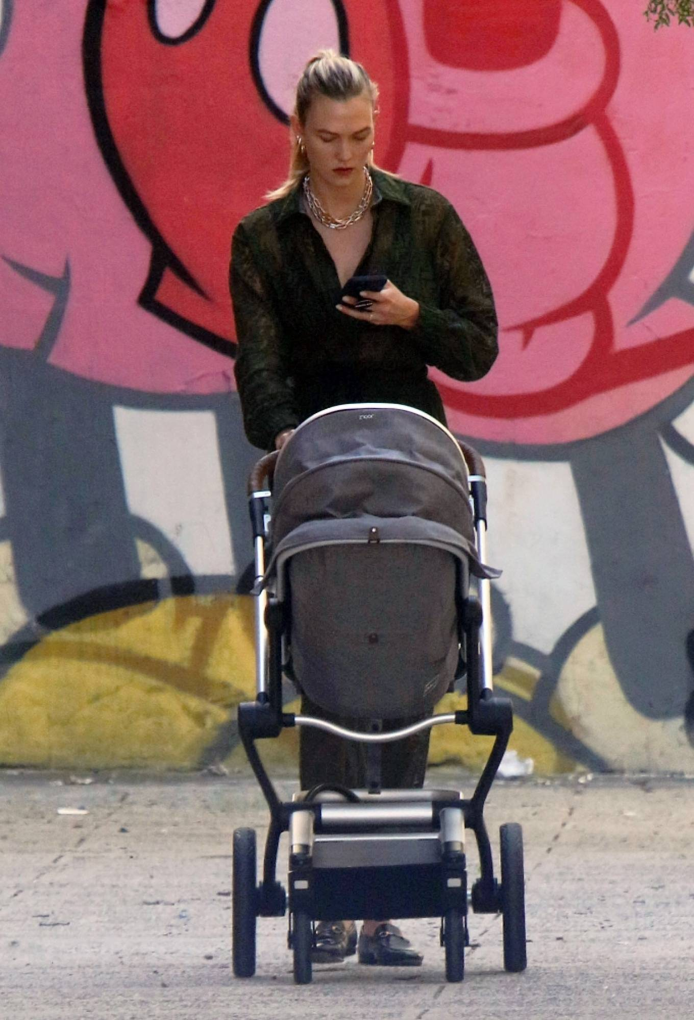 Karlie Kloss - seen walking baby Levi in Soho in New York City