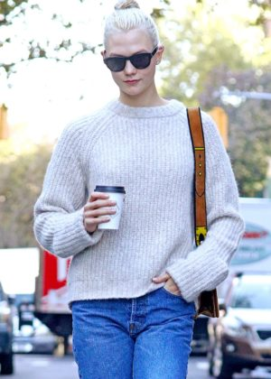 Karlie Kloss wearing a taupe sweater and loose fitting jeans in NYC