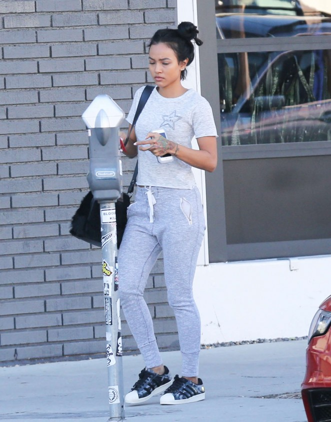 Karrueche Tran feed the meter while out in Los Angeles