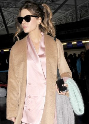 Kate Beckinsale in a silky pink pantsuit at LAX in Los Angeles