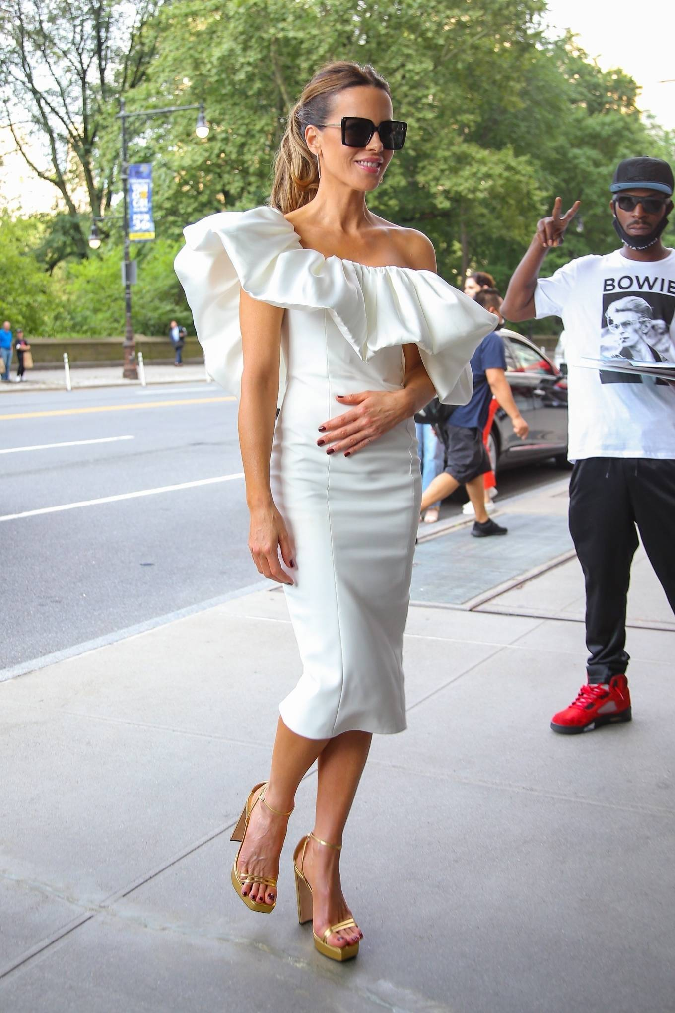 Kate Beckinsale - In white tight dress seen out in New York