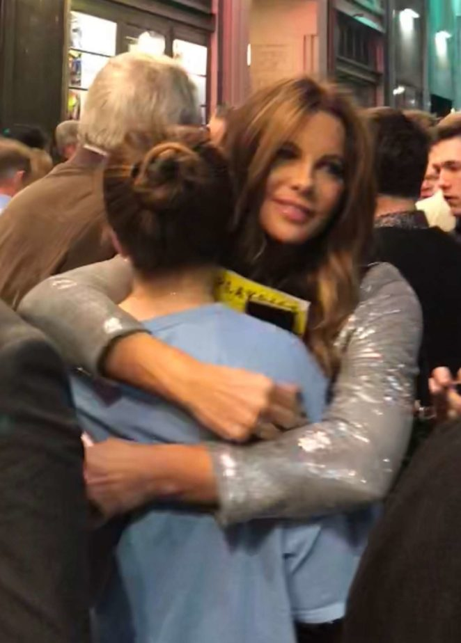 Kate Beckinsale - Shares a hug with a friend at the Pantages Theatre in Hollywood