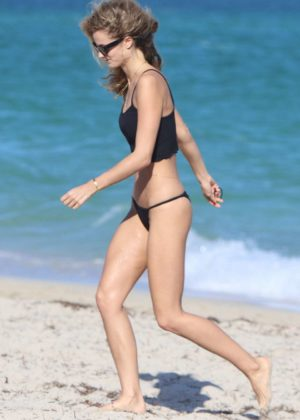 Kate Bock in Black Bikini at the beach in Miami