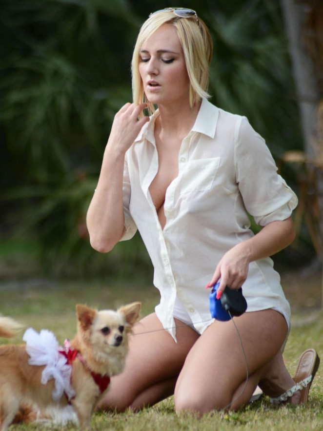 Kate England walking her dog in in Miami