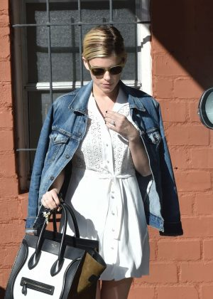 Kate Mara in a denim jacket and short dress out in West Hollywood