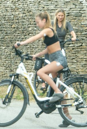 Kate Moss and daughter Lila Grace test their new electric bikes in Cotswold