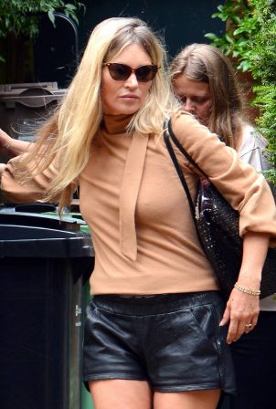 Kate Moss - In black leather shorts out in North London