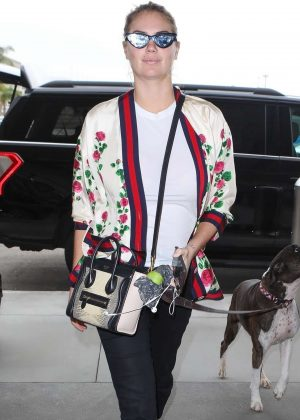 Kate Upton and her dog at LAX Airport in Los Angeles