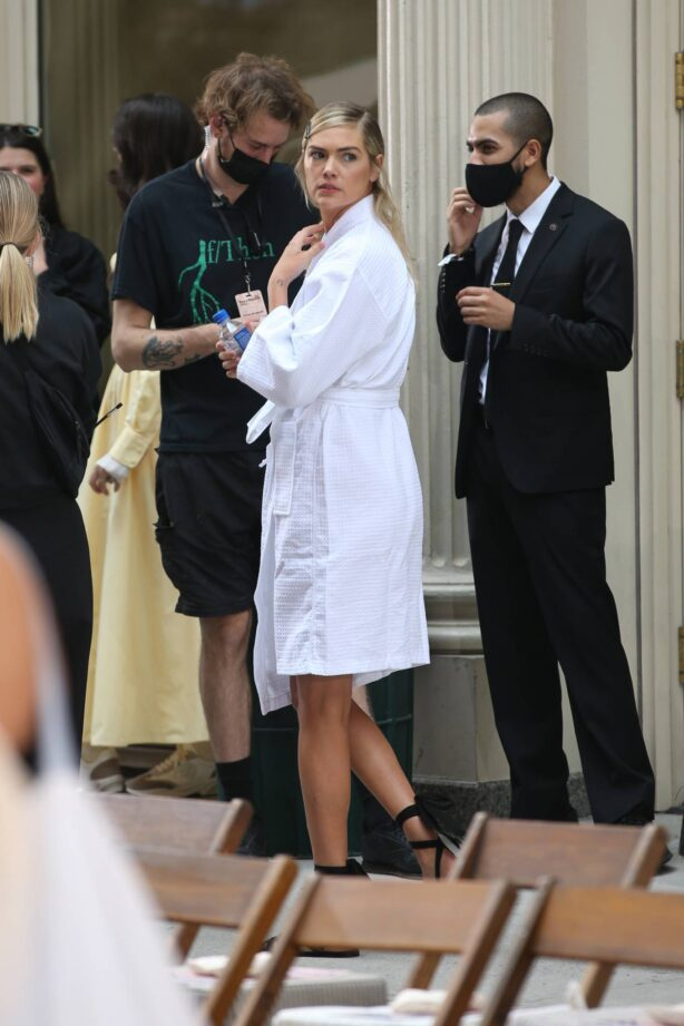 Kate Upton - In a white bathrobe during New York Fashion Week