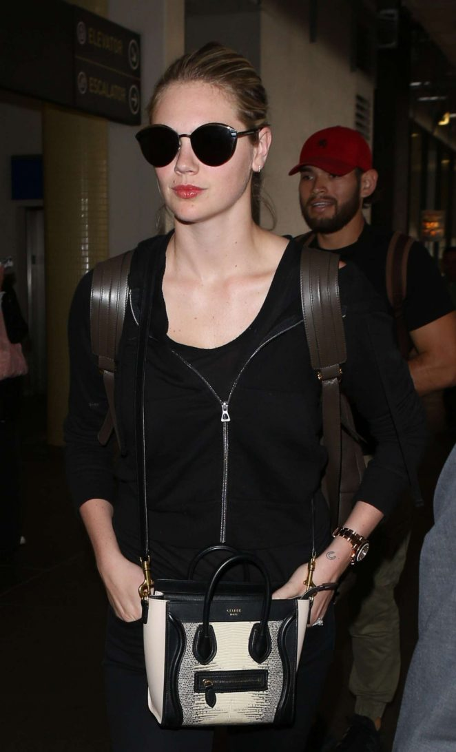 Kate Upton in Black at LAX airport in Los Angeles