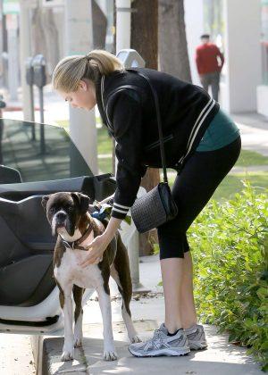 Kate Upton in leggings walking her dog in LA